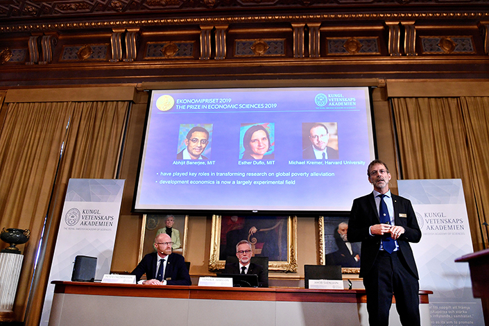 The three winners of the 2019 Nobel Prize in Economics get announced during a news conference at the Royal Swedish Academy of Sciences in Stockholm, Sweden, on Oct. 14. Photo: VCG