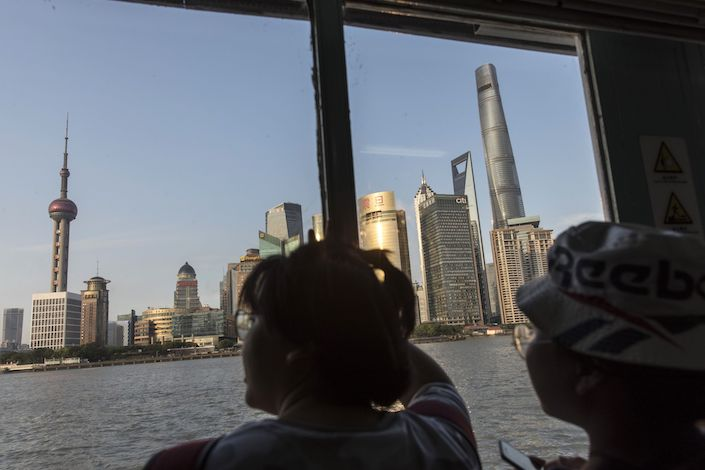 Passengers ride on a ferry crossing the Huangpu River towards Pudong in Shanghai. Photo: Bloomberg