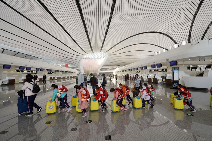 Passengers push their luggage through Beijing's brand new Daxing International Airport on Sunday. Photo: VCG