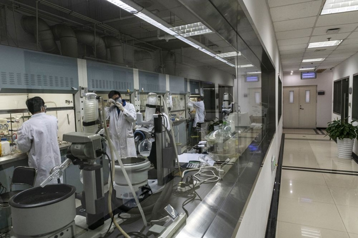 Researchers work inside a laboratory at BeiGene's research and development center in Beijing. Photo: Bloomberg