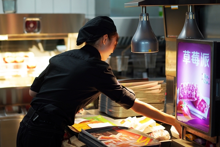 A member of staff at a McDonald's in Xiamen, Fujian province, on Sept. 10. Photo: VCG