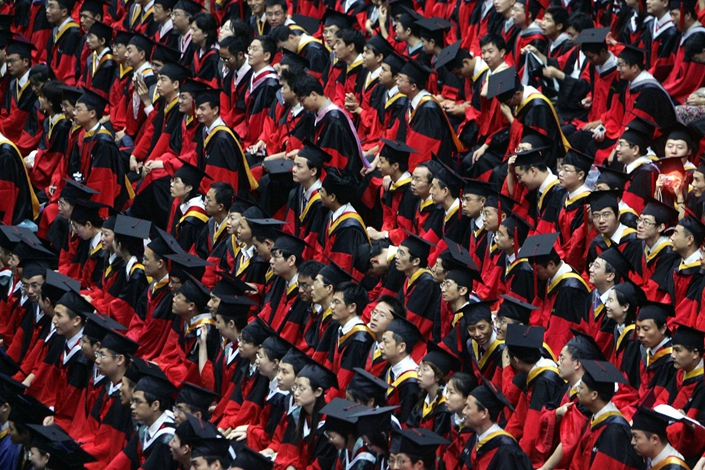 Students graduate during a ceremony at the Tsinghua University on July 18, 2007 in Beijing. Photo: Bloomberg