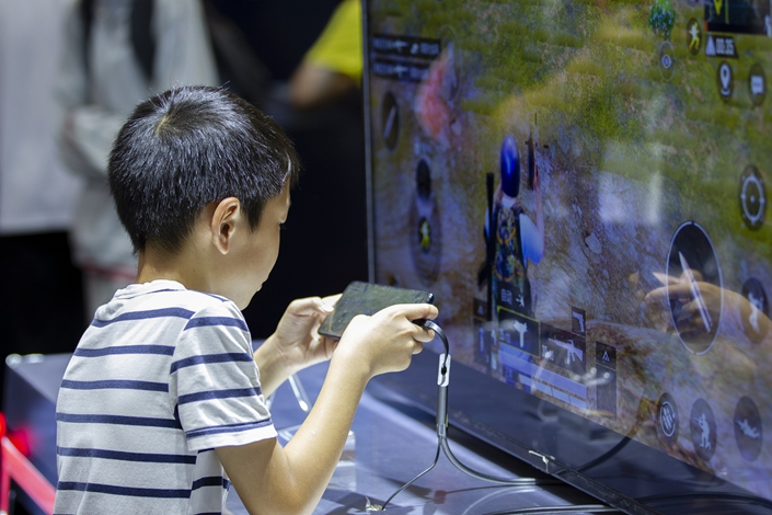 A child plays an online game at a gaming industry event in Shanghai on Aug. 2. Photo: VCG