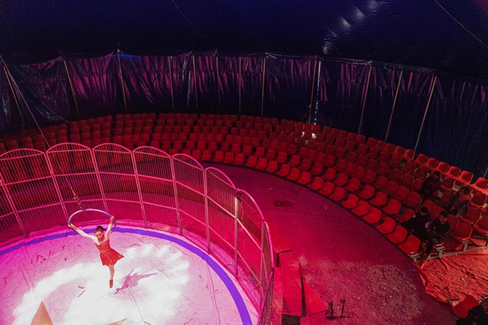 The last day of performances over China's national day holiday at the Qingzhou scenic area in Shandong province on Oct. 7. There were only a handful of people in the 600-seat theater.  Photo: Chen Liang/Caixin