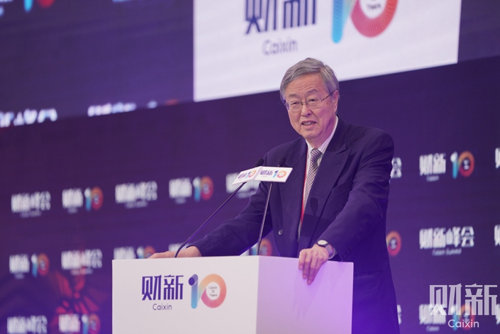 Zhou Xiaochuan gives an opening speech at the 10th Caixin Summit on Nov. 8. Photo: Cai Yingli/Caixin