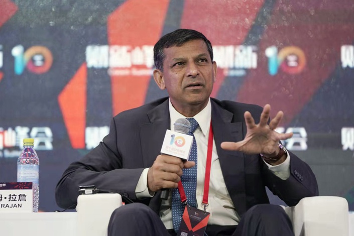 Raghuram Rajan, a former governor of the Reserve Bank of India, speaks at the Caixin Summit in Beijing on Friday. Photo: Caixin