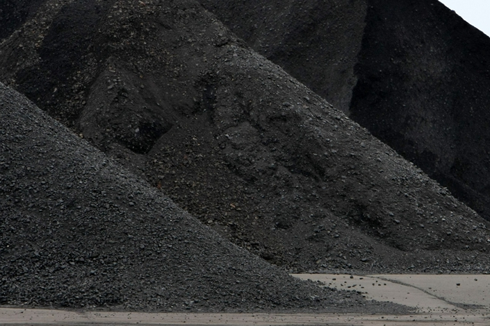 Coal is stockpiled after being imported at the Onahama port in Iwaki City, Fukushima Prefecture, Japan, on Feb. 6, 2012.  Photo: Bloomberg