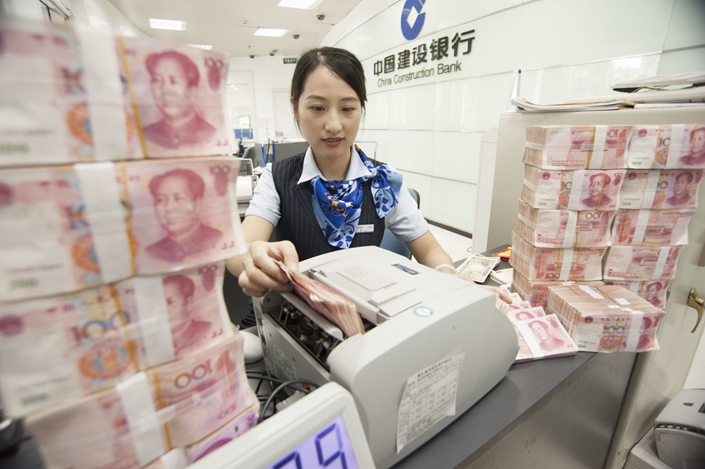 Some managers at the Beijing branch of China Construction Bank forced small commercial borrowers to buy life insurance products developed by the bank's life insurance subsidiary, national authorities said. Photo: IC Photo