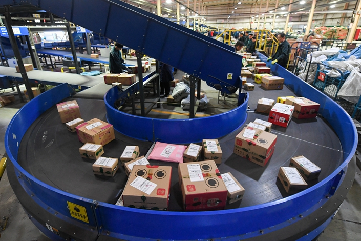 Packages are sorted in Taiyuan, Shanxi province, on Nov. 12. Photo: VCG