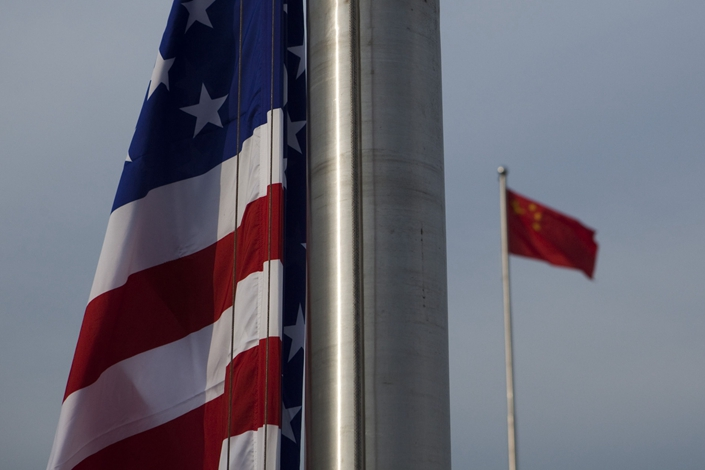 The U.S. flag flies next to the Chinese Flag in Beijing on Nov. 16, 2009. Photo: Bloomberg