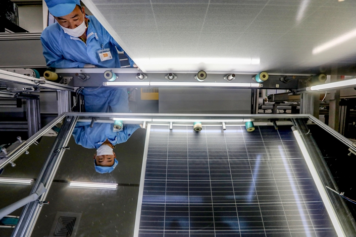 Workers make solar panels in Ningbo, East China's Zhejiang province, on Nov. 27. Photo: IC Photo