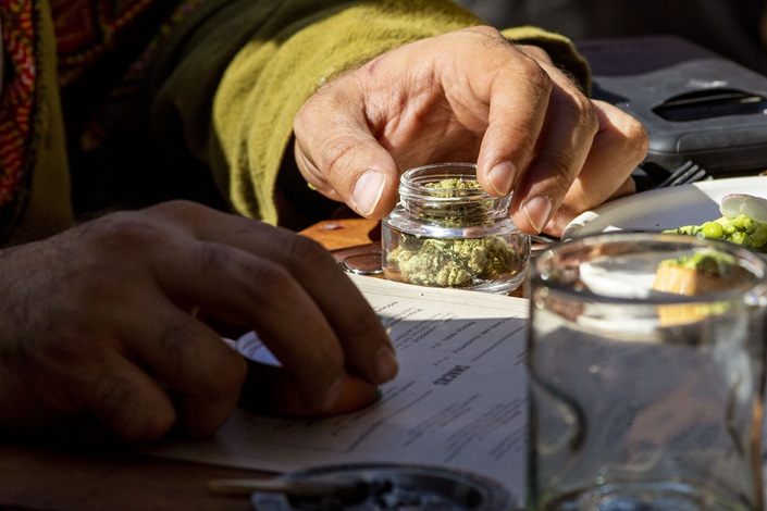 A customer holds a jar of marijuana at the Lowell Cafe, a new cannabis lounge in West Hollywood, California, U.S., on Tuesday. Photo: VCG