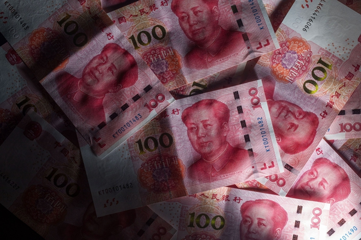 The People's Bank of China added 300 billion yuan through the medium-term lending facility, with 286 billion yuan being used to roll over loans coming due on Monday. Photo: Bloomberg