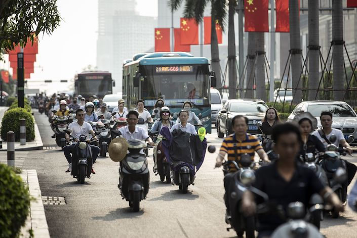 Morning commuters on motorbikes travel down a main thoroughfare in Nanning. Photo: Bloomberg
