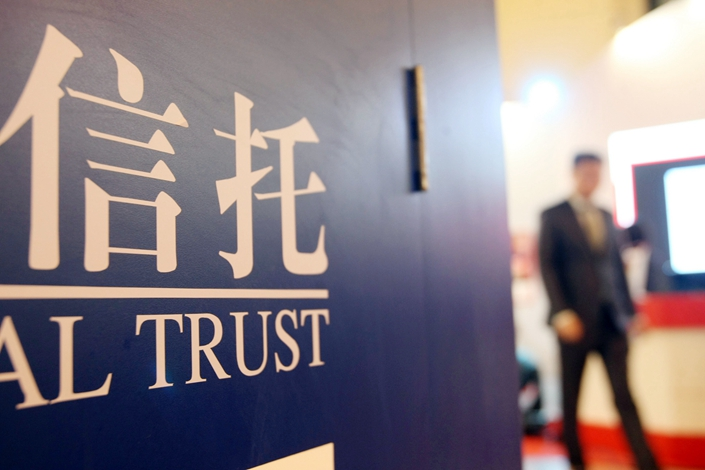 China's banking regulator and central bank have penalized at least 22 of 68 Chinese trust companies this year.