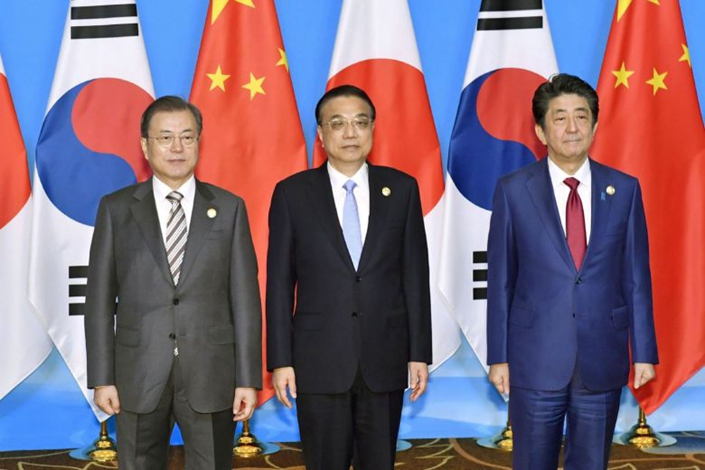 China's Premier Li Keqiang (center), alongside Japan's Prime Minister Shinzo Abe (right) and South Korea's President Moon Jae-in at the 8th trilateral leaders' meeting between China, South Korea and Japan in Chengdu, Sichuan province, on Dec. 24. Photo: The Straits Times