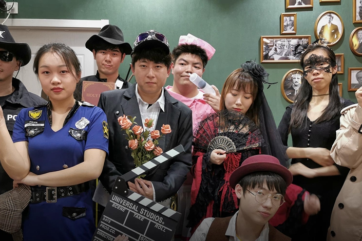 "Jiang Yunchuan (crouching in front) and his friends pose for a photo on May 15 before starting their script murder ""Blood-Red Wedding"" in Shanghai. Photo: Courtesy of Jiang Yunchuan"