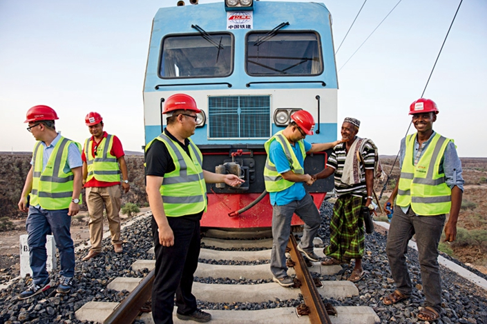 A local resident talks with staff working on the Addis Ababa–Djibouti Railway in Ethiopia in September 2016. The railway was built by the Railway Group.