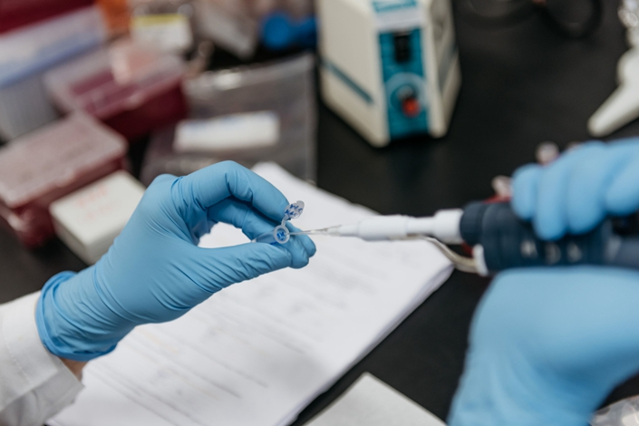 A laboratory technician pipettes a test sample in Hong Kong on  June 20, 2017. Photo: Bloomberg