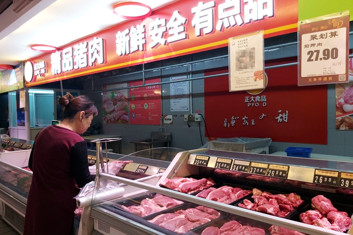 Soaring pork prices push up Chinese food costs