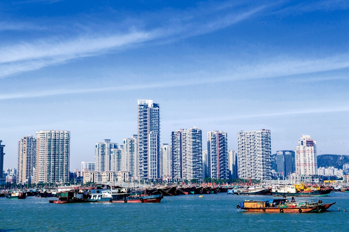 Apartment buildings line the coast of Zhuhai, South China's Guangdong province, on Nov. 3.