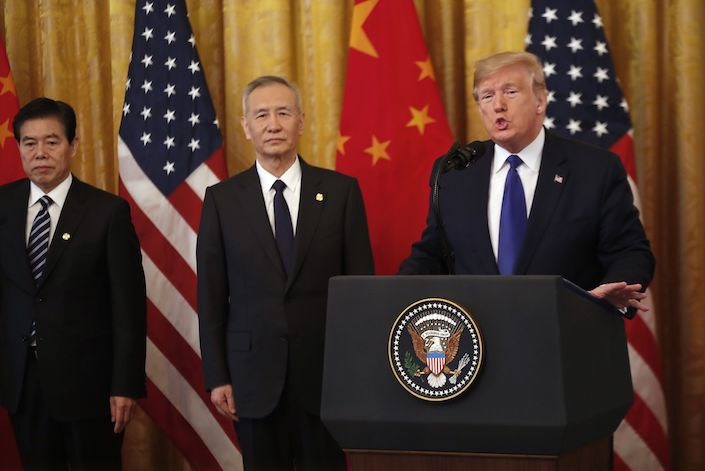 U.S. President Donald Trump and China's Vice Premier Liu He signed the phase one trade deal Jan. 15 at the White House. Photo: Bloomberg