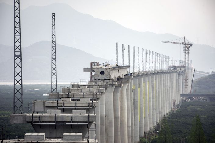 Pylons stand in a neat row at a high speed railway construction yard  in Taizhou