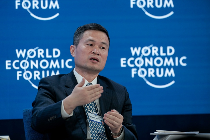 Fang Xinghai, vice chairman of the China Securities Regulatory Commission, speaks during a panel session on the opening day of the World Economic Forum in Davos, Switzerland, on Tuesday. Photo: Bloomberg