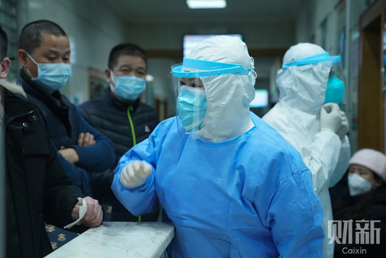 Reporter's Notebook: On the Front Lines of Wuhan's War Against Coronavirus