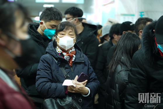 Reporter's Notebook: Anxiety Inside a Wuhan Fever Clinic