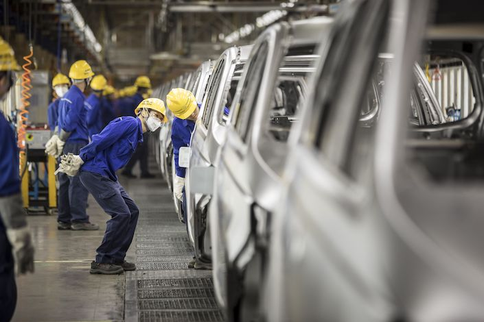 Employees work in the weld shop at the SGMW Baojun Base in Liuzhou. Photo: Bloomberg