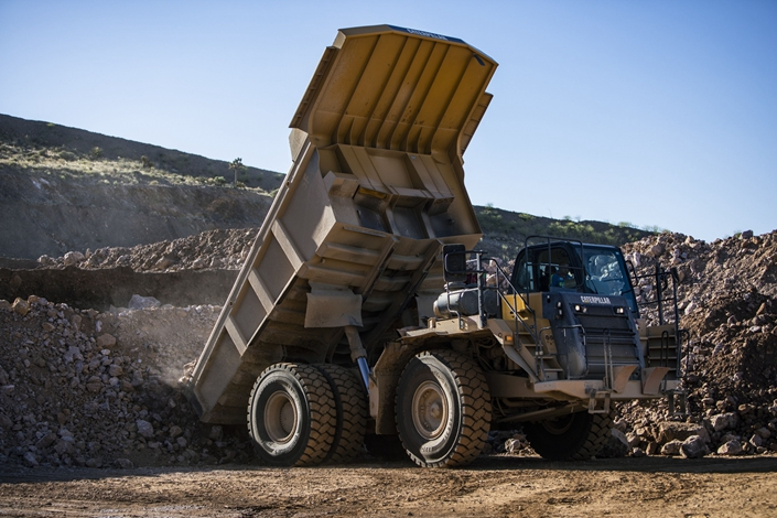 High grade raw ore is gathered for crushing at a mine. Photo: Bloomberg