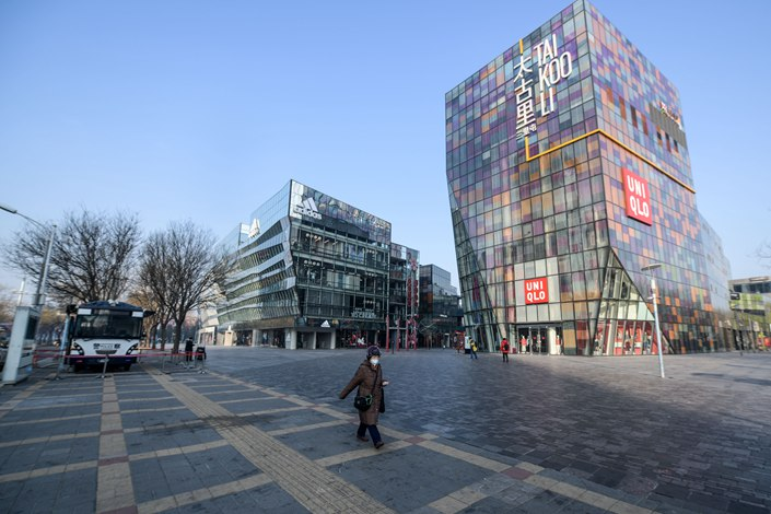 A pedestrian walks through a mall in Beijing's usually bustling Sanlitun neighborhood on Jan. 29. Photo: IC Photo