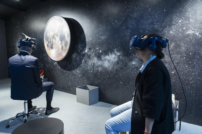 Visitors interact with virtual reality art at Art Basel on March 28, 2019 in Hong Kong. Photo: Bloomberg