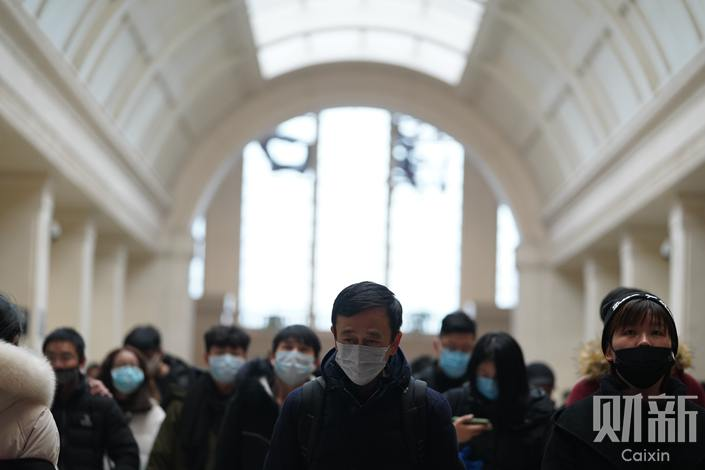 Passengers at Hankou Railway Station in Wuhan, Central China's Hubei province, wear face masks to protect themselves from the novel coronavirus. The station was later closed to contain the outbreak. Photo: Ding Gang/Caixin