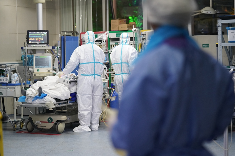 Doctors apply treatment to a patient in the intensive care unit at the South Central Hospital in Wuhan on Feb. 4