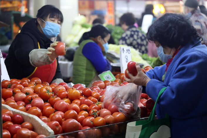 Residents of Nanjing, Jiangsu province, buy vegetables at a market. Photo: IC Photo