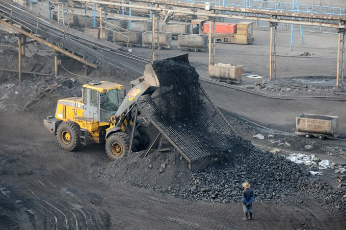Workers dump coal in Huaibe, East China's Anhui province. Photo: IC Photo