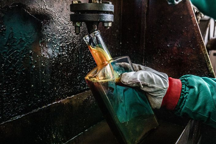 An employee takes samples in the Duna oil refinery in Szazhalombatta, Hungary, on Feb. 13. Photo: Bloomberg