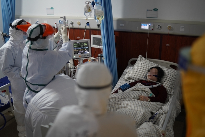 As of Feb. 11, the government acknowledged more than 1,700 medical workers nationwide as confirmed with the disease. Photo: Caixin