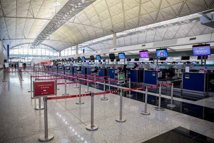 Check in counters are seen at Hong Kong International Airport in Hong Kong on Monday, Feb. 17, 2020. Photo: Bloomberg