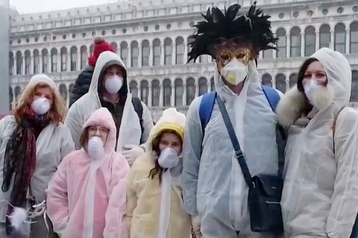 Attendes at Venice's Carnival wear protective clothing. Photo: CCTV