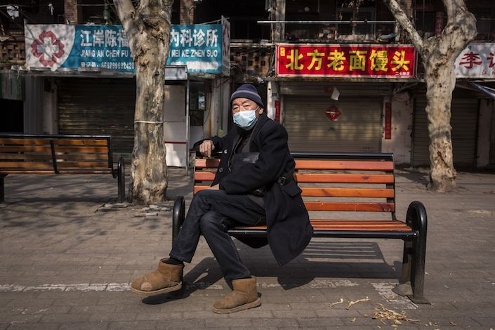 An old man sits on a bench in Wuhan on February 5, 2020. Photo: Bloomberg