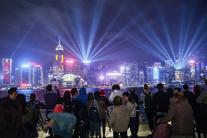 Tourists watch a light show at Victoria Harbour in Hong Kong on Dec. 24. Photo: IC Photo
