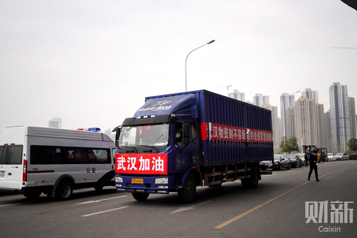 A truck carrying donations arrives in Wuhan on Feb. 2. The sign on the front of the truck reads