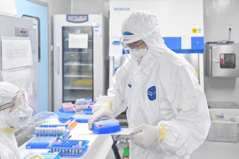 Laboratory technicians in Guangzhou conduct nucleic acid tests for Covid-19 on Feb. 18.