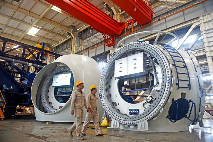 Wind turbines are examined at a factory in Tianjin. Photo: IC Photo