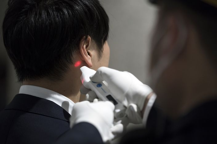 Doctors try to understand why recovered Covid-19 patients test positive again. Photo: Bloomberg