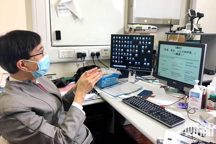 Microbiologist Yuen Kwok-yung in his office at Hong Kong's Queen Mary Hospital. Photo: Wen Simin/Caixin