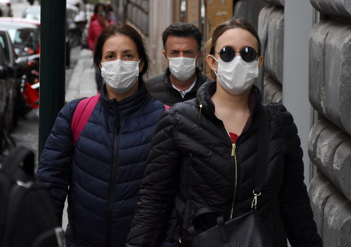 Pedestrians wearing face masks in Rome, Italy on March 2. Photo: IC Photo